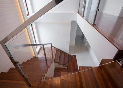 Modern stylish wooden and glass staircase in minimalistic design